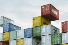 Space Invader made of cargo containers in a harbor